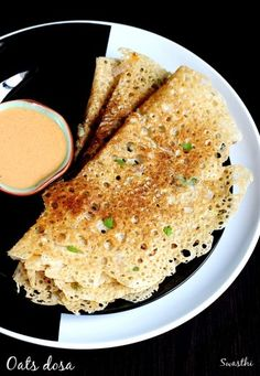 Oats dosa recipe - a healthy way to consume oats. Learn to make oats dosa with step by step photos. These instant dosa turns out to be crispy and tasty