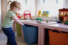 Ikea and Land of Nod mashup. Ikea Lack tables combined with big Land of Nod storage baskets