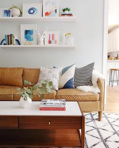 wall color, leather couch, pops of blue
