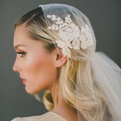 "Veiled Beauty's ""Pour the Champagne"" veil. Handmade out of bubbly-colored illusion tulle, this light and elegant Juliet cap gathers in the back and features a subtle Alencon lace appliqué for added interest."