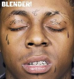Lil Wayne tattoos: his 4 tear drops which are for the people who have been killed in his family, 'Fear God' and the 'C' between his eyes which is for his mother 'Cita' and his last name 'Carter'. 10 Creepiest Eyelid Tattoos (creepy tattoos) - ODDEE