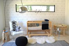 Cool-factor nursery with Charles Hollis Jones lucite rocking chair, natural wood crib, arc floor lamp and modern graphic wall covering  | Tompkins Lloyd Interiors
