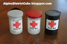 Alpine District Cub Scouts: First Aid Film Cannister Cub Scout Neckerchief Slides