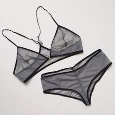 super simple set using grey mesh from spandex world and black FOE for the trim. i opened up the cf a bit with a decorative gold piece, but it was unnecessary! next time i'll overlap the cups like the directions advise. the undies fit perfectly. they're my fave pattern.