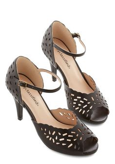 Quite the Paragon Heel. Your friends look to you when style inspiration is needed, as youre always perfectly ensembled from head to toe - and today your toes are adorned in these black peep-toe heels. #black #modcloth