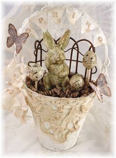 Pretty Large Peat Pot Easter Bunny Love the rusty fence and spring banner
