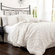Cotton-blend comforter set with an embroidered diamond motif. Product: Queen: 1 Comforter, 1 bedskirt and 2 standard s...