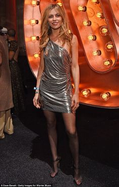 6dd79b3ad9 Abbey Clancy looks worse for wear as she parties at BRIT Warner do