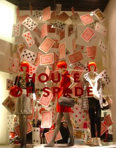 Kate Spade Window Display - trade out cards for book covers or pages & put in the library