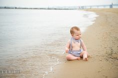 Cute baby boy sitting on the beach by the water. Chesapeake Bay, Kent Island, Annapolis, Eastern Shore Maryland children and family lifestyle portrait photo session by photographers of Leo Dj Photography. http://leodjphoto.com