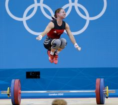 Poland's Aleksandra J Klejnowska-Krzywanskareacts during the women's 53-kg, group A, weightlifting competition at the 2012 Summer Olympics, Sunday, July 29, 2012, in London. (AP Photo/Hassan Ammar)