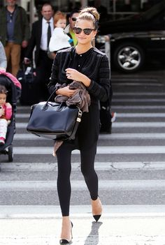 Chrissy Teigen's Givenchy Antigona Medium Tote is the perfect handbag that can also act as a carry-on.