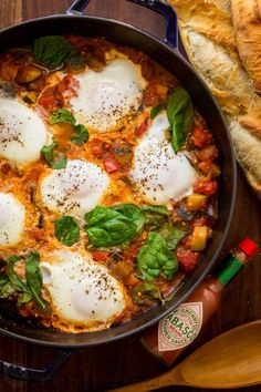 This Ratatouille Brunch Skillet is loaded with zucchini, hearty eggplant and bell peppers in a spicy tomato based sauce, crowned with egg and fresh spinach. | natashaskitchen.com