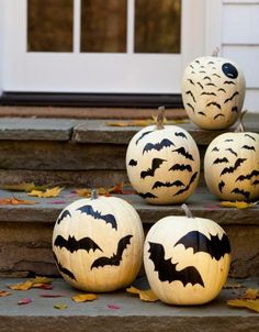 Painted bats look spooky on your doorstep! More pumpkin ideas: http://www.midwestliving.com/homes/seasonal-decorating/pumpkin-decorating-projects/page/25/0