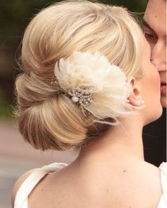 Vintage wedding updo with feather fascinator, very glam