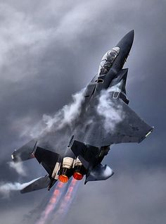 The McDonnell-Douglas/Boeing F-15 Eagle climbs into the air with its Pratt & Whitney F100 afterburning engine