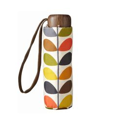 Orla Kiely: A perfect gift for any Orla Kiely fan, this compact umbrella features our signature Multi Stem print encased in a Multi Stem gift box. This extremely compact umbrella is made from lightweight rustproof aluminium and fibreglass, weighing just 164g. The frame is especially designed to be flexible for maximum wind resistance. The large canopy measures 85cm when open for maximum coverage.