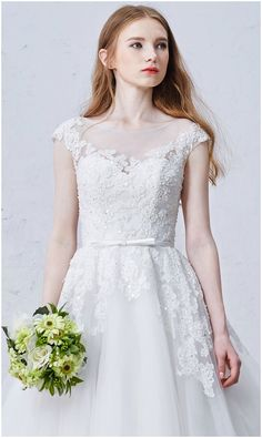 Custom made-to-order formal dress by GemGrace. Multiple colors and all sizes available. Additional photos also available upon request. Shop this Romantic Ball-Gown Scoop Neck Sweep Train Tulle Wedding Dress With Appliques Lace on GemGrace.