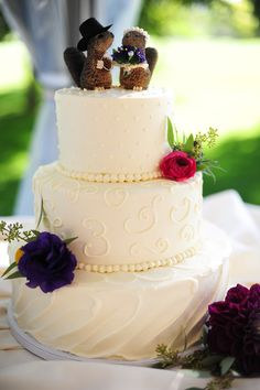 White Wedding Cake With Animal Cake Topper
