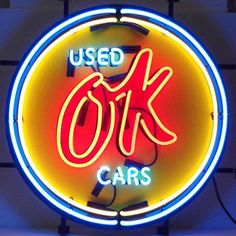 Ok Used Cars Neon Sign is very bright! Neon Signs feature multi-colored, hand blown neon tubing. The glass tubes are backed by a beautiful silkscreened full-color image, and the entire sign is support