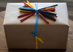 Uninflated balloons also make unique ribbons: | 24 Cute And Incredibly Useful Gift Wrap DIYs - for a kid's gift