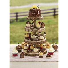 David Tutera™ Rustic Wood Slice Cupcake Stand: 12 x inches - Don't forget about the dessert table! Our David Tutera™ rustic wood cupcake stand features 4 wood slice tiers that are perfectly sized for holding bite-size sweets like mini cupcake Wood Cupcake Stand, Rustic Cupcake Stands, Rustic Cupcakes, Cupcake Stand Wedding, Wooden Cake Stands, Wedding Cake Stands, Wedding Cake Toppers, Wedding Cakes, Fruit Wedding