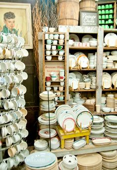 Fishs Eddy the best old flea market booth display of Diner China coffee cups and dishes. eye catching.
