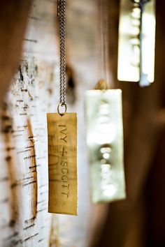 Hand stamped chains serve as escort cards! Mountain Splendor   Wedding design by Ivy Robinson Events, photo by Old South Studios