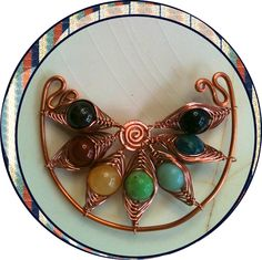 Seven Sisters One gemstone for each Chakra, suspended in copper coils