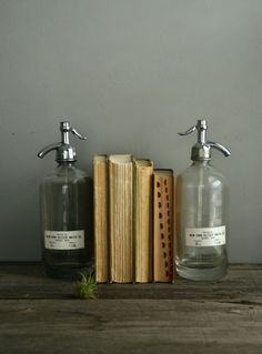 seltzer bottles re-purposed as bookends.