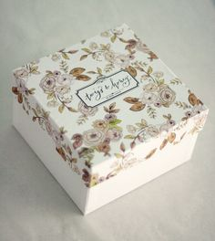 something lovely like this? your pretty artwork turned lid cover and your lovely name on the tippy top (maybe in sticker form and some lovely ribbon tied under it?)