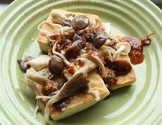 """Korean panfried tofu, warm mushroom medley and spicy sauce. Professional cookbook reviewer and author T. Susan Chang picked this """"Asian Tofu"""" recipe to kick off her 2012 list of favorite recipes."""