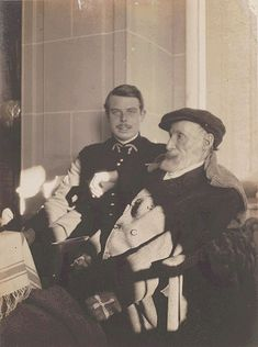"""Auguste et Jean Renoir, ca 1916 -by Pierre Bonnard[some say """"attributed"""" to P. Bonnard, other confirm the autorship] Jean, son of Auguste Renoir, is shown here in army uniform for the war (1914-18); he will make his anti-war famous movie, La grande Illusion, in 1937.This photo also shows how handicapped Auguste Renoir was in his last years; he will paint until his death (in 1919), his paintbrushes tied to his hand."""