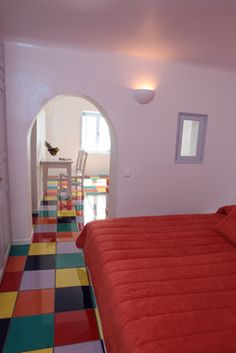 Colorful-Tiles-Built-Bed-Hotel-Bedroom-Built-Consoles-Santorini-Holidays-Greece