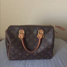 ✨Louis Vuitton Speedy 25✨ One of my favorite bags needs to go to a new home! Absolutely immaculate condition, zero rips, stains or tears. Patina has darkened on handles and evenly to a beautiful honey color. Perfect every day bag and roomy! Has been taken care of very well. Looking to sell, but open to selective trades for other LV or Chanel.  ISO of a LV boulogne 30! Trade value: 1000 Louis Vuitton Bags