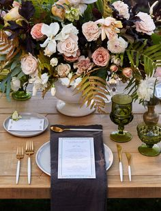 Elegant tabletop with gold + white flatware