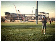Coach Art Briles & granddaughter Kinley admire McLane Stadium across the Brazos River after #SpringBU practice. #family #Baylor
