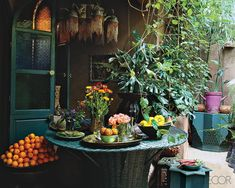 oranges, a chandelier...indoor/outdoor living without pretense, love it
