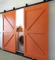 Hidden Washer/Dryer Behind Sliding Barn Doors, Remodelista