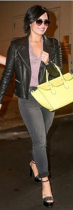 Who made  Demi Lovato's black platform studded sandals and yellow tote handbag?