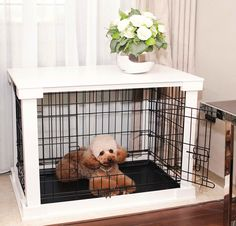 This cute dog crate turns a traditional pet cage into a functional table surface, which lets it double as a stylish piece of furniture