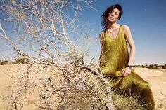 Liu Wen graces the March 2017 cover of ELLE China wearing a Louis Vuitton sheer dress with sparkling embellishments. Photographed by Li Qí, the Chinese model poses in the desert for the accompanying spread. Wearing looks from the spring collections ranging from sparkling gowns to ruffled tops, Liu gets styled by Jin Jing. Liu dazzles...[Read More]