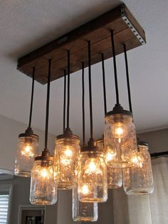 How To Make A Mason Jar Chandelier Primitive Home Decorating Every Dining Room Needs One Of These Diy Rustic Mason Jar Light Hanging Mason Jar Light Out Of Mason Jars Cafe Lights And A Wood… Mason Jar Chandelier, Mason Jar Lighting, Pendant Chandelier, Mason Jar Lamp, Rustic Chandelier, Pendant Lights, Kitchen Chandelier, Mason Jar Light Fixture, Mason Jars