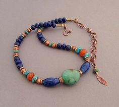 This Moroccan inspired colorful necklace features a chunky genuine turquoise stone front and center. Its vibrant teal color is accented by genuine
