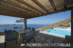Two large pergolas provide shade on each side of the poo and a large lounge area with a built sofa to enjoy the sunset are just a few steps away with the outdoor dining area equipped with a stunning dining table. FMV1501 Villa for Rent on Mykonos island Greece. http://florios-mykonos-villas.com/property/fmv1501/