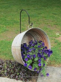 """Adorable This is what I am going to put in the """"Back in the day"""" flower bed along with the old Metal wagon wheel and old metal milk can spilling """"milk"""" but I think I will put pansies in it or som .."""