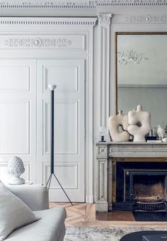 living room TV could be hidden behind the mirror via Vogue living gorgeous architecture in this Parisian apartment Living Room Tv, Living Room With Fireplace, Fireplace Mantle, Fireplace Ideas, Fireplace Design, Living Area, Interior Ikea, Interior Exterior, Interior Architecture