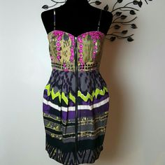 Very unique Kouture by Kimora Dress Size Medium Sexy ans unique Kimora Dress Zips in front Size medium Has pockets  Very colorful and eye catching!  Bust - 32 inches Waist - 28 inches Length - 34 inches Kouture by Kimora Dresses Mini