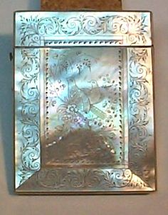 Engraved Mother of Pearl Card Case A very pretty example of engraved mother of pearl. We undertook remedial work around the hinge area