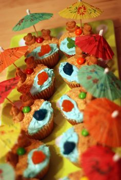 cute beach cupcakes; teddy grahams, crushed teddy grahams for sand, skittles for beach balls, finding nemo fruit snacks for fish in water :)